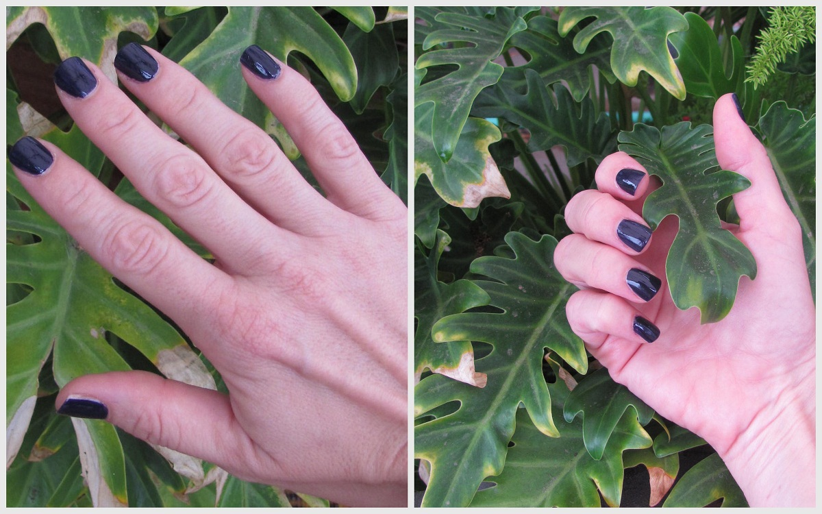 Author's hands in dark polish