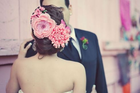 large flowers in hair, wedding look