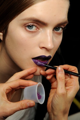 Model with purple lipstick