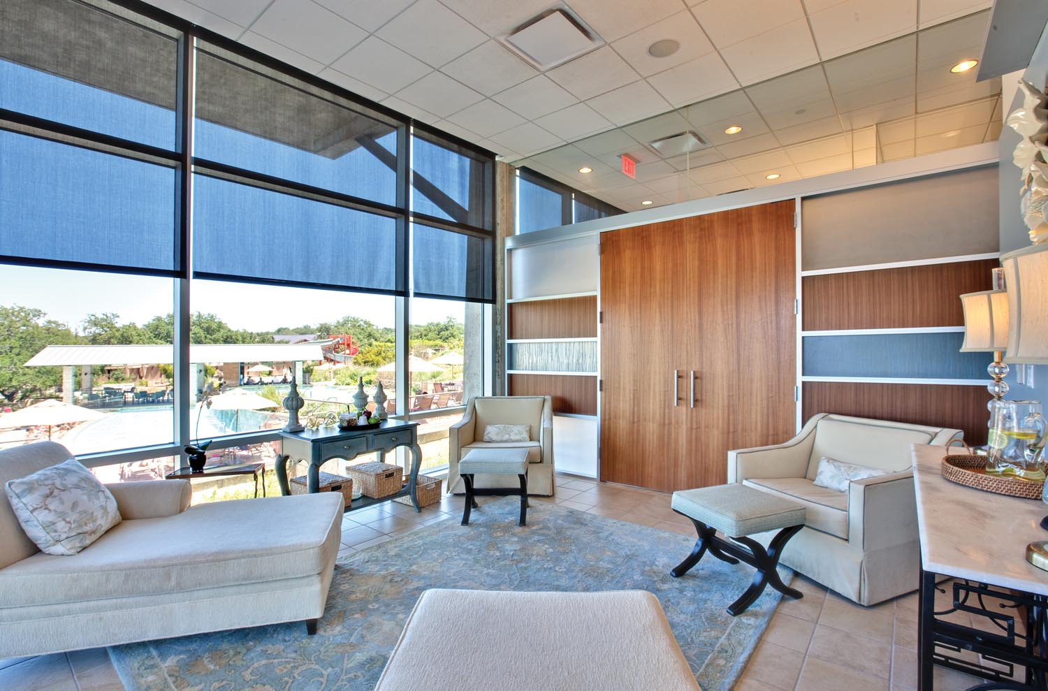 women's lounge with view of pool