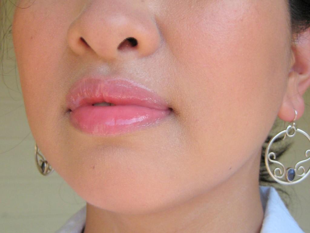 Jenn wearing Bite Beauty Lip Shine in Melon