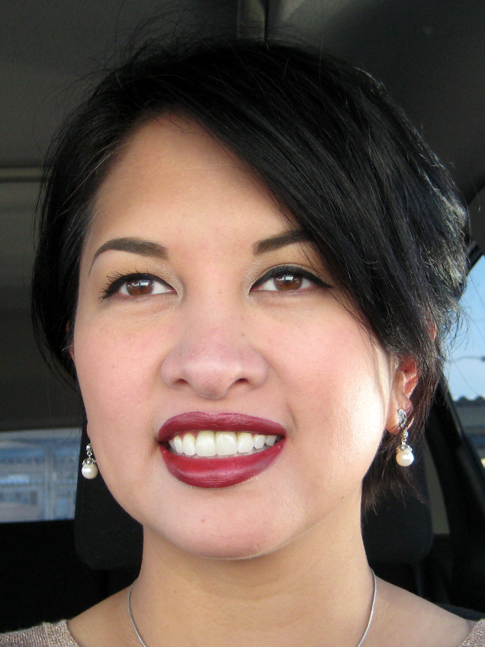 Jenn wearing holiday makeup look, vamp lipstick