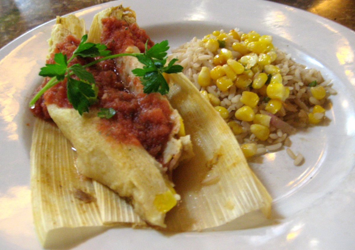 plate of tamales carnitas with brown rice and corn