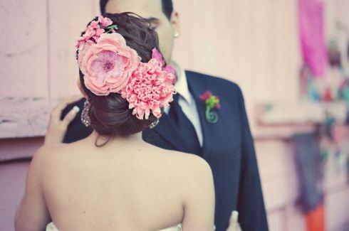 large flowers in hair, wedding look