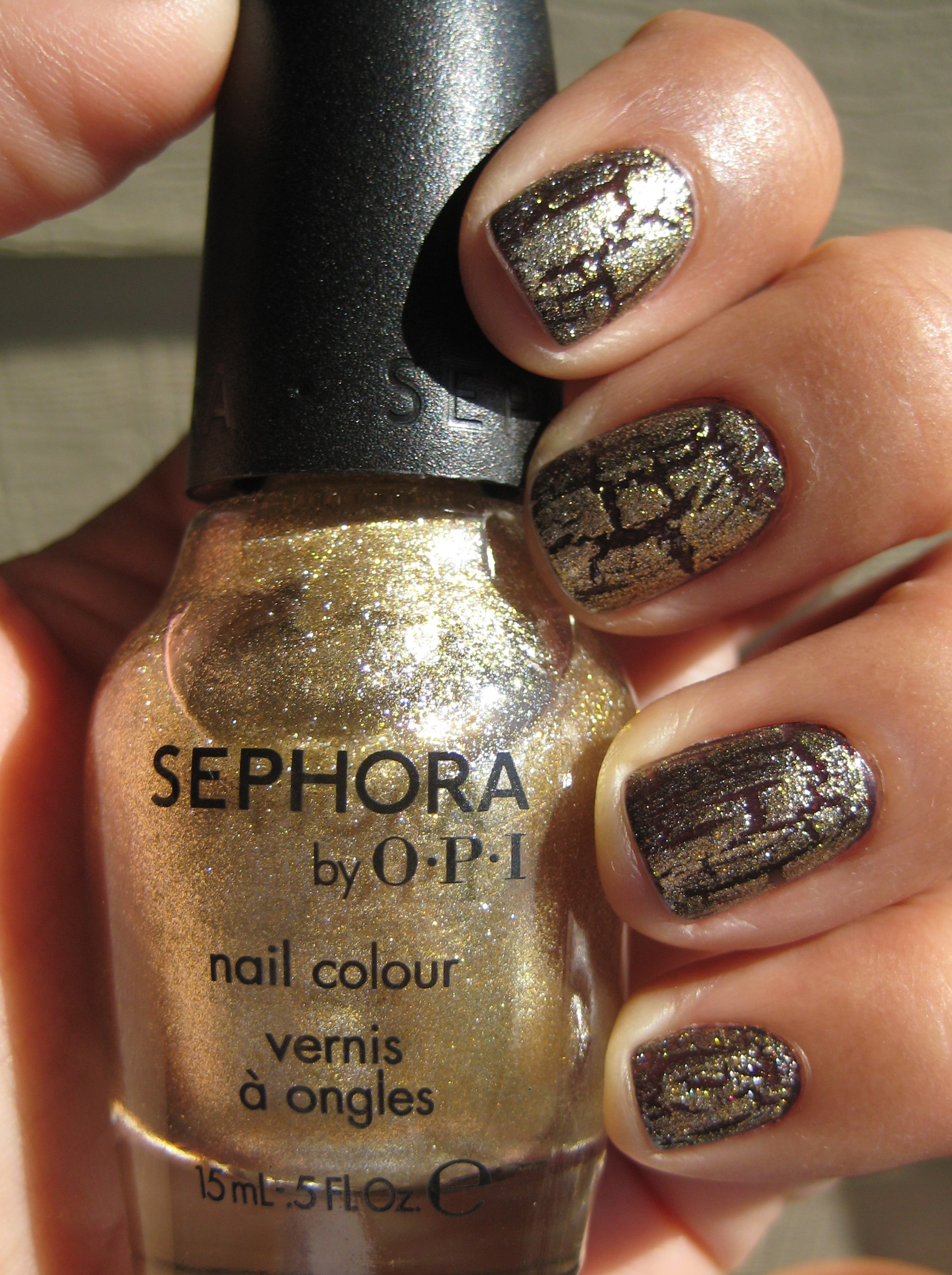 Jenn wearing Sephora by OPI Blasted Gold top coat over OPI Nail Lacquer in Tease-y Does It